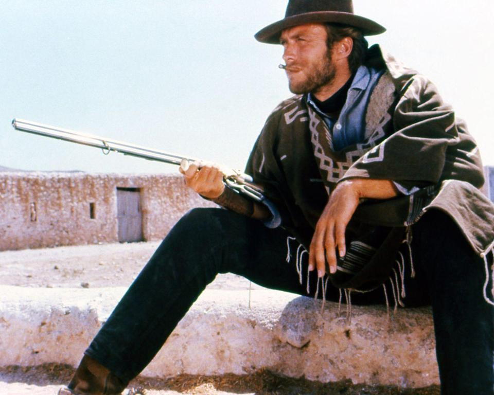 <p>Before his days as suit-clad <em>Dirty Harry</em>, Clint Eastwood made a name for himself sporting denim in Western films. Here, the actor is seen filming a scene in <em>A Fistful of Dollars</em>, wearing dark jeans and a woven poncho. </p>