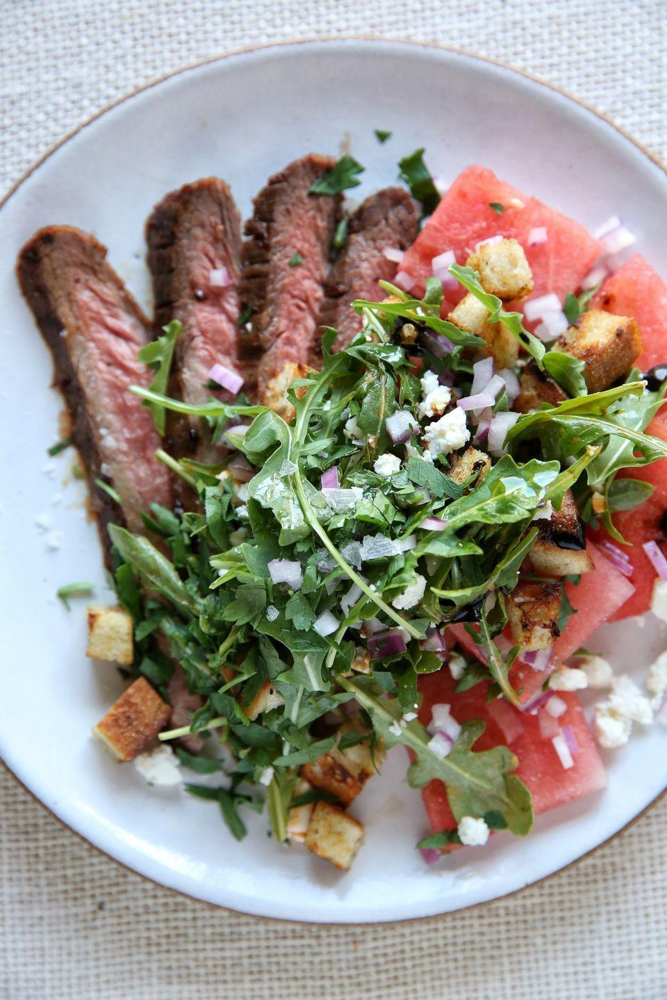 """<p>This simple steak-and-salad combo is classy enough for a summer dinner party.</p><p>Get the recipe from <a href=""""https://www.delish.com/cooking/recipe-ideas/recipes/a48012/flank-steak-with-watermelon-salad-recipe/"""" rel=""""nofollow noopener"""" target=""""_blank"""" data-ylk=""""slk:Delish"""" class=""""link rapid-noclick-resp"""">Delish</a>.</p>"""