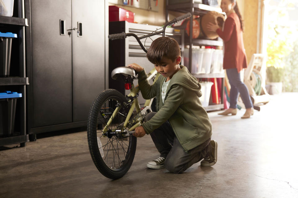 Child fixing bicycle with hand tools from Canadian Tire, easy DIY fixes