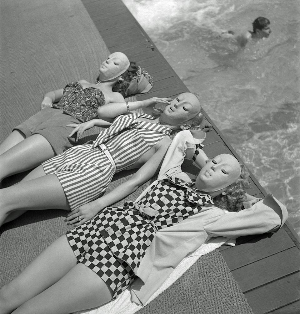 <p>They say that the sun makes your skin age like nothing else, but protective tan masks, like the ones these three ladies wore in 1950, look downright creepy. </p>