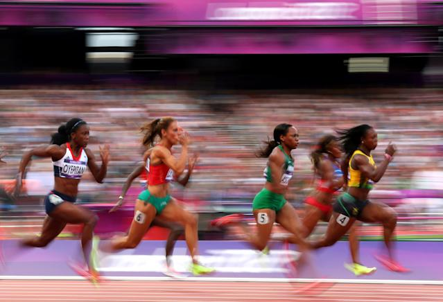 LONDON, ENGLAND - AUGUST 03: (L-R) Abiodun Oyepitan of Great Britain, Ivet Lalova of Bulgaria, Gloria Asumnu of Nigeria and Veronica Campbell-Brown of Jamaica compete in the Women's 100m Round 1 Heats on Day 7 of the London 2012 Olympic Games at Olympic Stadium on August 3, 2012 in London, England. (Photo by Alex Livesey/Getty Images)
