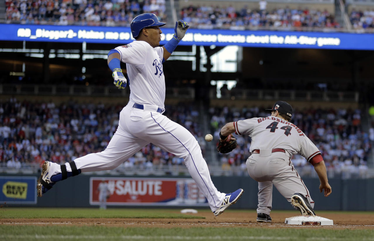 American League's Salvador Perez, of the Kansas City Royals, is thrown out at first base as National League first baseman Paul Goldschmidt, of the Arizona Diamondbacks, covers in the second inning of the MLB All-Star baseball game, Tuesday, July 15, 2014, in Minneapolis. (AP Photo/Jeff Roberson)