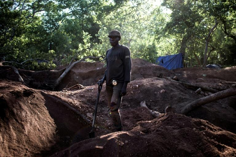 An illegal miner stands in an area rich with gold and rubies on the outskirts of Montepuez, Mozambique