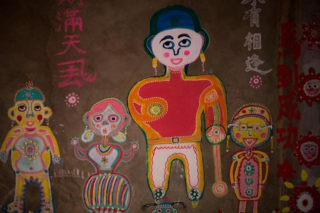 TAICHUNG, TAIWAN - JULY 22: A colourful mural at the Rainbow Military Dependents' Village on July 22, 2013 in Taichung in Taiwan. The village, one of more than 800 settlements built for retired Chinese soldiers after World war II, has become a distinctive tourist attraction after a retired soldier, Huang Yung-fu, painted hundreds of brightly coloured murals. (Photo by Lam Yik Fei/Getty Images)