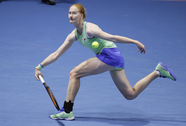 Alison van Uytvanck of Belgium returns the ball to Petra Kvitova of Czech Republic during the St. Petersburg Ladies Trophy-2020 tennis tournament match in St.Petersburg, Russia, Thursday, Feb. 13, 2020. (AP Photo/Dmitri Lovetsky)
