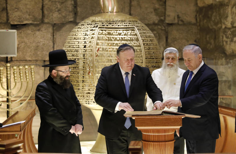 From left Rabbi of the Western Wall Shmuel Rabinovitch U.S Secretary of State Mike Pompeo center Israeli Prime Minister Benjamin Netanyahu visits the Western Wall tunnels synagogue in Jerusalem's Old City on Thursday