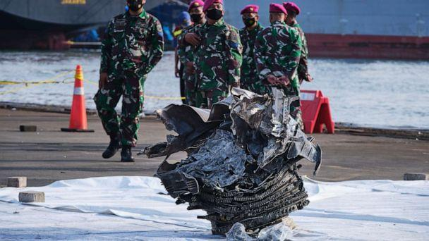 PHOTO: A piece of one of the engines of Sriwijaya flight SJ182 sits on the dock awaiting examination by crash investigators on Jan. 11, 2021, in Jakarta, Indonesia. (Ed Wray/Getty Images)