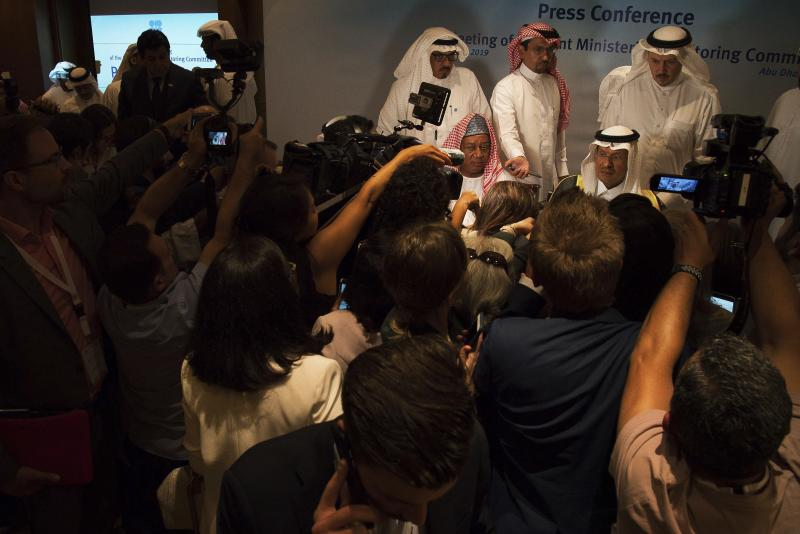 "Saudi Energy Minister Prince Abdulaziz bin Salman, seated right, and OPEC Secretary-General Mohammed Barkindo, seated left, speak to journalists after a news conference that followed an OPEC meeting in Abu Dhabi, United Arab Emirates, Thursday, Sept. 12, 2019. OPEC's Joint Ministerial Monitoring Committee met Thursday in Abu Dhabi as estimates of lowered crude oil demand in 2020 have the cartel considering additional production cuts. Before the meeting started, Prince Abdulaziz again called for ""cohesiveness"" in OPEC. (AP Photo/Jon Gambrell)"