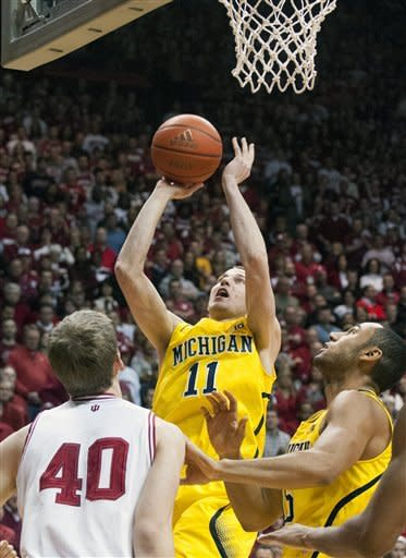 Michigan's Nik Stauskas (11) puts up a shot against Indiana during the first half of an NCAA college basketball game Saturday, Feb. 2, 2013, in Bloomington, Ind. (AP Photo/Doug McSchooler)