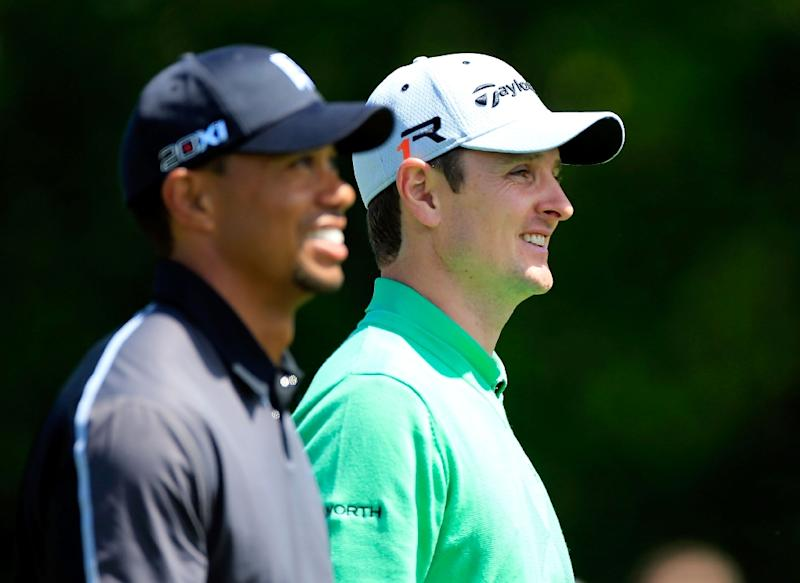 Tiger Woods (L) and Justin Rose, seen during the Arnold Palmer Invitational, at the Bay Hill Club and Lodge in Orlando, Florida, in 2013