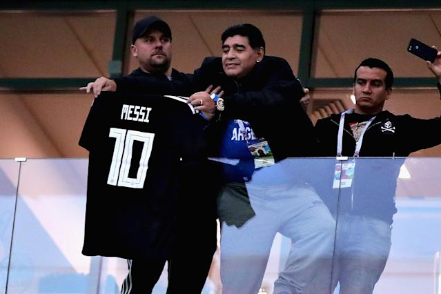 <p>Former Argentina player Diego Maradona holds a tribute shirt for Lionel Messi of Argentina before the 2018 FIFA World Cup Russia group D match between Argentina and Croatia at Nizhny Novgorod Stadium on June 21, 2018 in Nizhny Novgorod, Russia. (Photo by Chris Brunskill/Fantasista/Getty Images) </p>