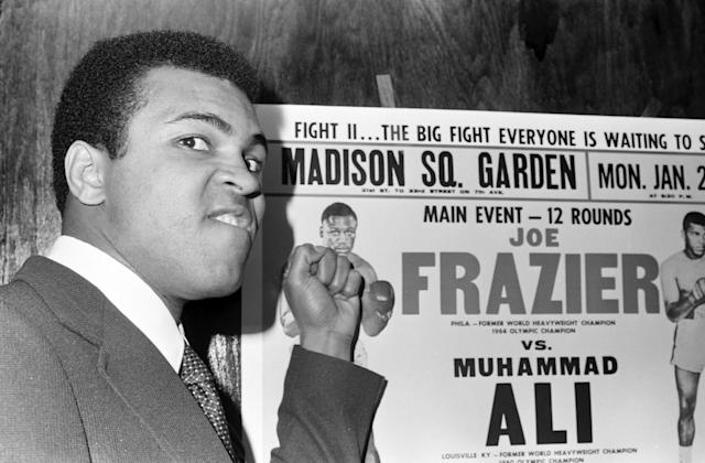 "<p>Muhammad Ali, a three-time heavyweight boxing champion, was as charismatic as he was skilled. Proclaiming himself ""The Greatest,"" he used his platform to speak about race, religion, and politics. He died at age 74 on June 3. — (Pictured) Muhammad Ali poses as he taunts Joe Frazier before the official press conference in 1974 for bout II at Pen Restaurant in New York, New York. (The Ring Magazine/Getty Images) </p>"