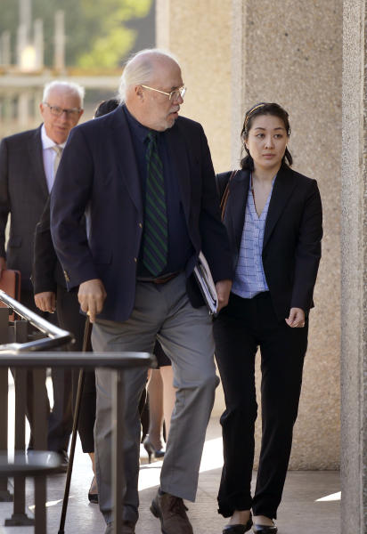 Tiffany Li, right, and her attorney Geoff Carr, left, arrive at the courthouse Thursday, Sept. 12, 2019, in Redwood City, Calif. The trial of Li, a Chinese real estate scion who posted a $35 million bail after being charged with orchestrating the 2016 murder of her children's father, is set to start Thursday.(AP Photo/Tony Avelar)