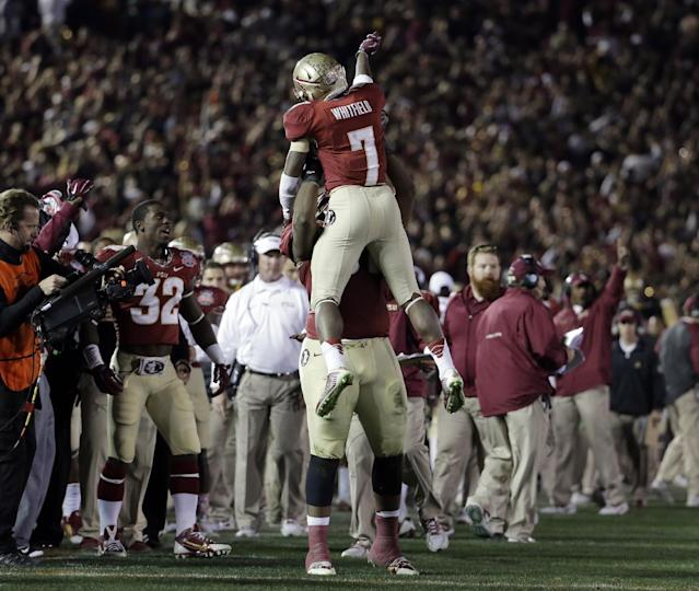 Florida State's Levonte Whitfield celebrates after running back a kickoff for a touchdown during the second half of the NCAA BCS National Championship college football game against Auburn Monday, Jan. 6, 2014, in Pasadena, Calif.(AP Photo/Chris Carlson)