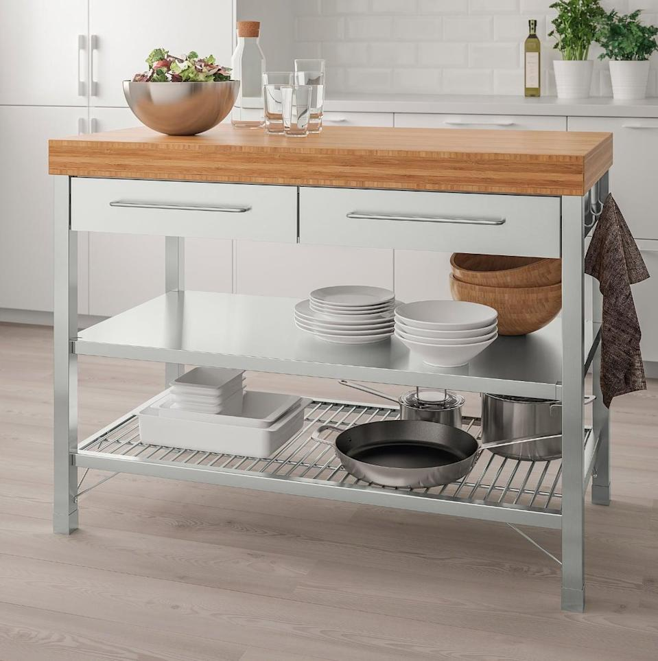 "<p>A two-in-one, the <a href=""https://www.popsugar.com/buy/Rimforsa%20Work%20Bench-447003?p_name=Rimforsa%20Work%20Bench&retailer=ikea.com&price=499&evar1=casa%3Aus&evar9=46151613&evar98=https%3A%2F%2Fwww.popsugar.com%2Fhome%2Fphoto-gallery%2F46151613%2Fimage%2F46152192%2FRimforsa-Work-Bench&list1=shopping%2Cikea%2Corganization%2Ckitchens%2Chome%20shopping&prop13=api&pdata=1"" rel=""nofollow noopener"" target=""_blank"" data-ylk=""slk:Rimforsa Work Bench"" class=""link rapid-noclick-resp"">Rimforsa Work Bench</a> ($499) offers a place to cook and prepare food, as well as additional storage space down below.</p>"