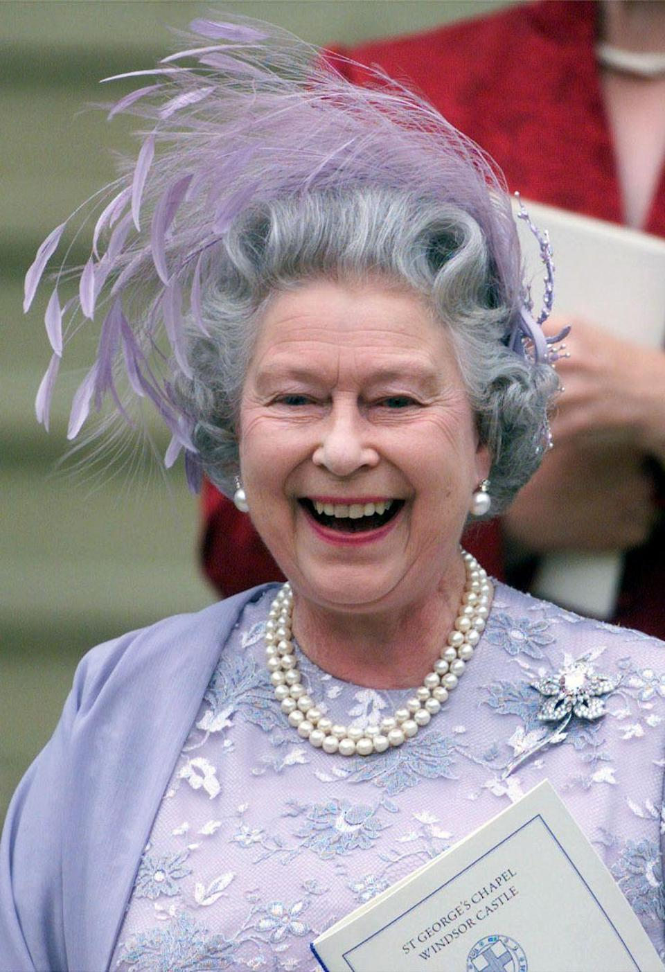 """<p>Queen Elizabeth II matched her mom in regal purple for the celebration.</p><p><strong><a href=""""https://www.townandcountrymag.com/society/tradition/g15881437/royal-weddings-history-windsor-castle-st-georges-chapel/"""" rel=""""nofollow noopener"""" target=""""_blank"""" data-ylk=""""slk:See more photos from that day here."""" class=""""link rapid-noclick-resp"""">See more photos from that day here.</a></strong></p>"""