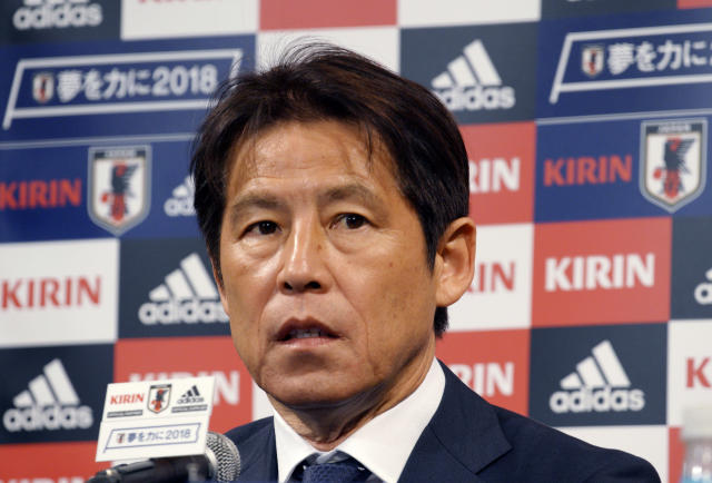 Japanese national soccer coach Akira Nishino answers a question during a press conference on an upcoming friendly match against Ghana Friday, May 18, 2018, in Tokyo. Keisuke Honda and Shinji Kagawa were named on Friday to Japan's squad for an international friendly on May 30 against Ghana in Yokohama.(AP Photo/Eugene Hoshiko)