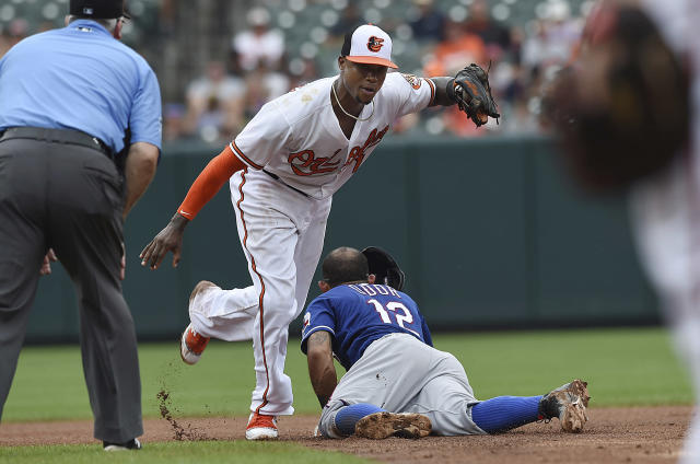 Texas Rangers' Roughned Odor (12) slides into second after being tagged out by Baltimore Orioles' Tim Beckham, center top, in the seventh inning of a baseball game, Sunday, July 15, 2018, in Baltimore. (AP Photo/Gail Burton)