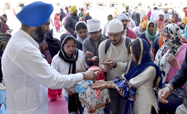 In the wake of COVID-19 outbreak, SGPC employees have been dispensing hand sanitizer to visitors as precautionary measure at the entrances of Golden Temple in Amritsar.