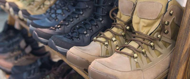 Army boots are in line at the store counter. Shoes