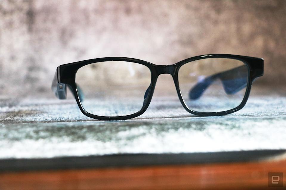 <p>Razer Anzu smart glasses review photo. Slightly left side angled view of the Razer smart glasses sitting on a desk with arms unfolded.</p>