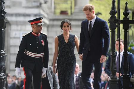 Britain's Prince Harry and his fiancee Meghan Markle arrive at a service at St Martin-in-The Fields to mark 25 years since Stephen Lawrence was killed in a racially motivated attack, in London