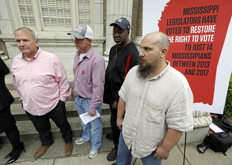 FILE - In this March 27, 2018, file photo, former convicts Wayne Kuhn, from left, Dennis Hopkins, Byron Coleman and Jon O'Neal hold a news conference in Jackson, Miss. A federal appeals court will hear arguments Tuesday, Dec. 3, 2019, on whether Mississippi laws that restrict the voting rights of certain felons are unconstitutional. Former convicted felons affected by the state's laws are pushing to have their voting rights restored. (AP Photo/Rogelio V. Solis, File)