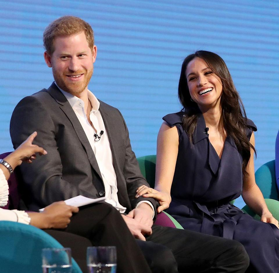 """<p>In their first <a href=""""https://www.harpersbazaar.com/celebrity/latest/a18838332/meghan-markle-kate-middleton-royal-foundation-forum/"""" rel=""""nofollow noopener"""" target=""""_blank"""" data-ylk=""""slk:joint-couple event"""" class=""""link rapid-noclick-resp"""">joint-couple event</a> alongside Kate and William, Meghan and Harry sat beside each other during the Royal Foundation Forum event held at Aviva in London. For the proctored section of the on-stage evening, Markle appeared extremely comfortable as she smiled widely and placed her hand on her fiancé's arm.</p>"""