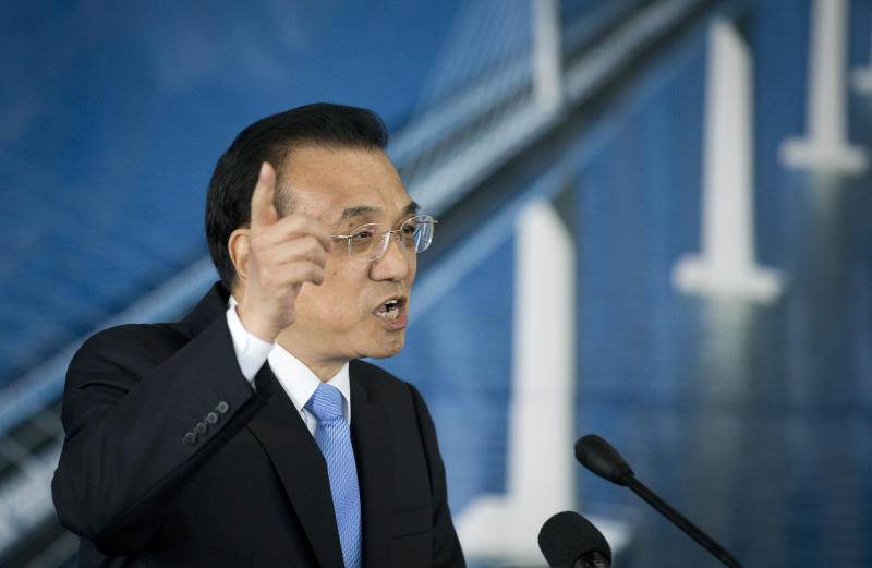 "China's Premier Li Keqiang speaks during a ceremony at the construction site of a bridge built by a Chinese company and largely EU founded, in Brijesta, Southern Croatia, Thursday, April 11, 2019. Croatia is hosting a summit on Thursday for China and 16 European countries that endorsed Beijing's global ""Belt and Road"" initiative. (AP Photo/Darko Bandic)"