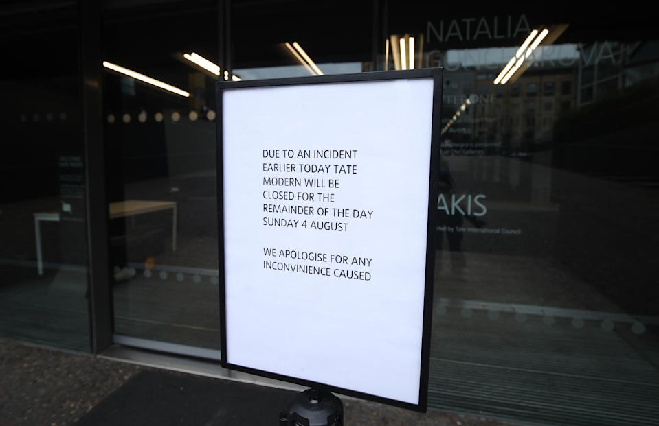 A sign posted outside of the Tate Modern reminds visitors the gallery closed earlier today due to an incident in which a teenager has been arrested after a child fell from height and was taken to hospital from the gallery in central London by air ambulance.