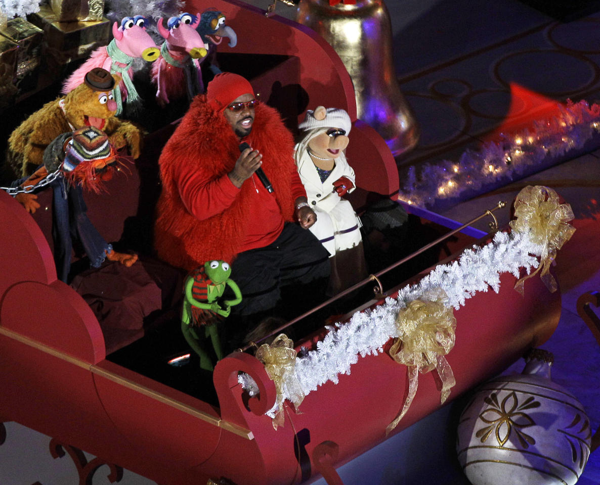 Singer CeeLo Green performs in a sleigh with the Muppets before the Rockefeller Center Christmas Tree lighting during the 80th annual tree lighting ceremony at Rockefeller Center in New York, Wednesday, Nov. 28, 2012. (AP Photo/Kathy Willens)