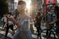 Japan extended a virus state of emergency after new cases topped 10,000 for the first time on Thursday