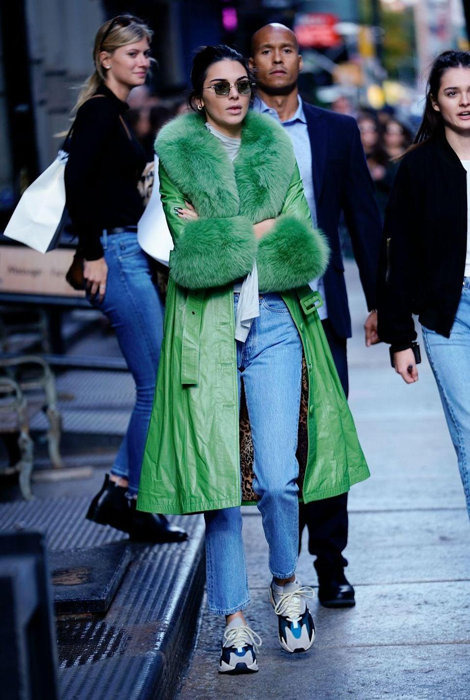 <p>For her 23rd birthday the reality star wore a green Saks Potts coats to cycle around New York, November 2018.</p>