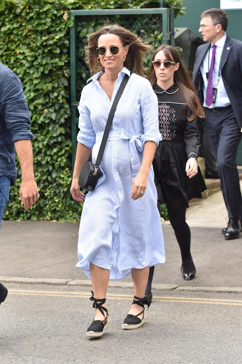 <p>Pippa Middleton served up some major fashion inspo over at Wimbledon 2018 on 11 July in a Ralph Lauren shirt dress, Penelope Chilvers espadrilles and a Pop and Suki cross-body bag. <em>[Photo: Getty]</em> </p>