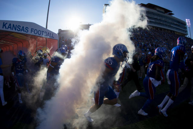 "<a class=""link rapid-noclick-resp"" href=""/ncaab/teams/kaa/"" data-ylk=""slk:Kansas Jayhawks"">Kansas Jayhawks</a> exit the tunnel during pregame introductions before taking on the <a class=""link rapid-noclick-resp"" href=""/ncaab/teams/rad/"" data-ylk=""slk:Rhode Island Rams"">Rhode Island Rams</a> on September 3, 2016 at Memorial Stadium in Lawrence, Kansas. (Getty Images)"