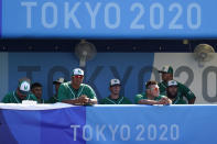 Mexico looks out from the dugout after losing a baseball game against Israel at Yokohama Baseball Stadium during the 2020 Summer Olympics, Sunday, Aug. 1, 2021, in Yokohama, Japan. (AP Photo/Matt Slocum)