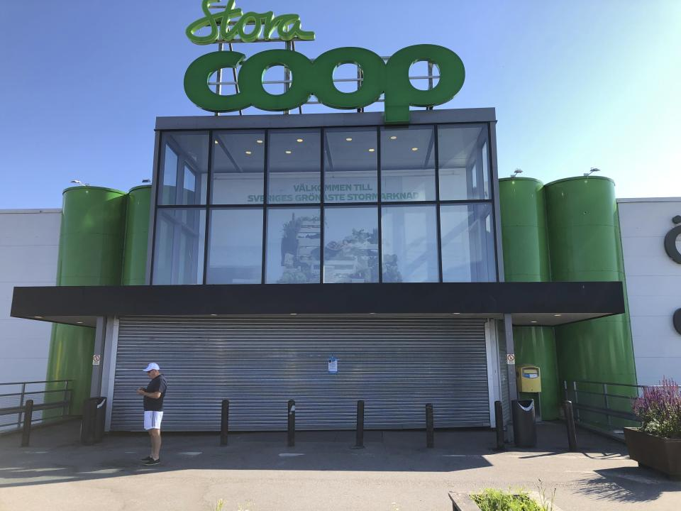 A closed Coop supermarket store in the suburb of Vastberga, Stockholm, Sweden, Saturday July 3, 2021. Cybersecurity teams worked feverishly Sunday July 4, 2021, to stem the impact of the single biggest global ransomware attack on record, with some details emerging about how the Russia-linked gang responsible breached the company whose software was the conduit. The Swedish grocery chain Coop said most of its 800 stores would be closed for a second day Sunday because their cash register software supplier was crippled. (Jonas Ekstromer/TT via AP, File)