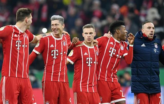 (From L) Bayern Munich's Niklas Suele, Robert Lewandowski, Joshua Kimmich, David Alaba and Franck Ribery react at the end of their German Cup DFB Pokal match against Borussia Dortmund, in Munich, on December 20, 2017