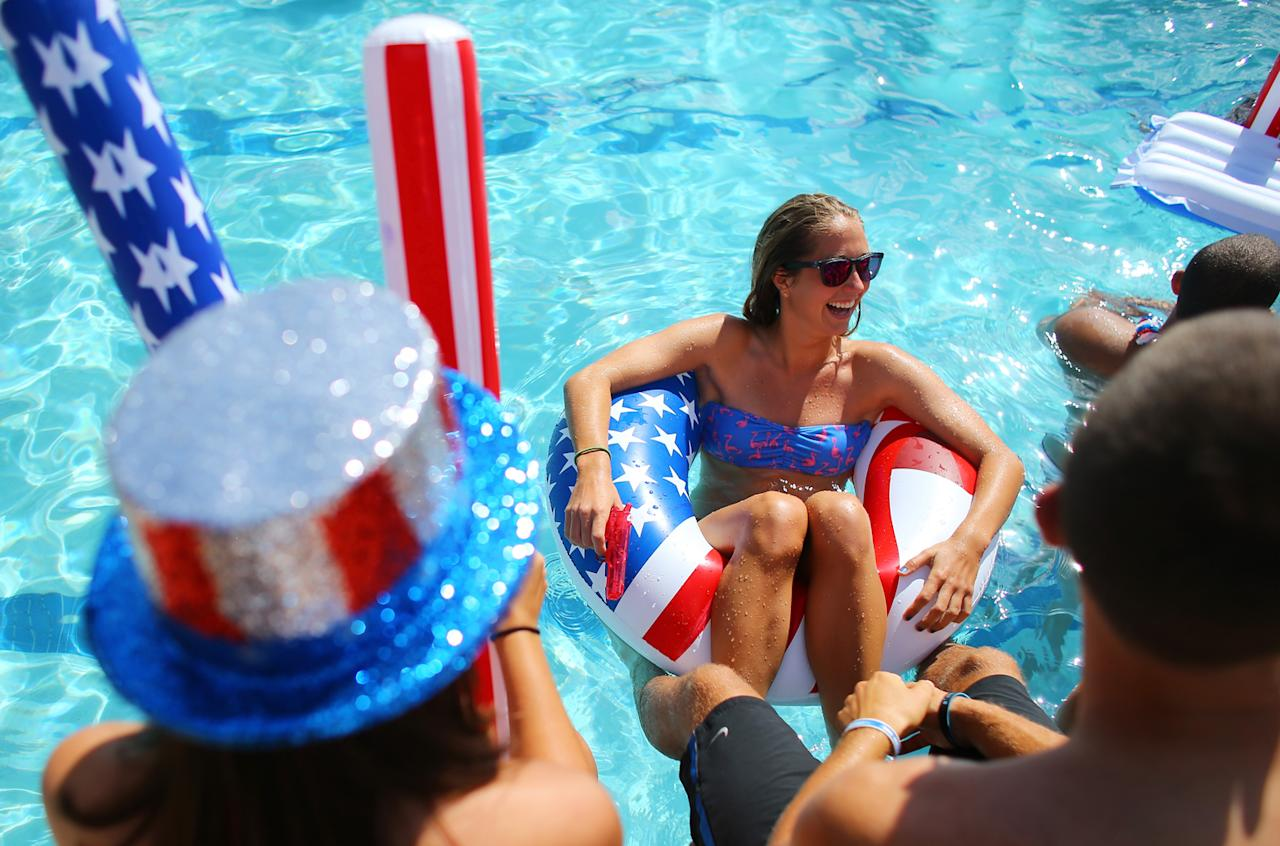 Students Shannon Anderson (L, hat) and Megan Rodwell (R) play in the campus pool prior to the debate between U.S. President Barack Obama and Republican presidential candidate Mitt Romney at Lynn University on October 22, 2012 in Boca Raton, Florida. The final presidential debate before election day on November 6th focuses on foreign policy.  (Photo by Joe Raedle/Getty Images)