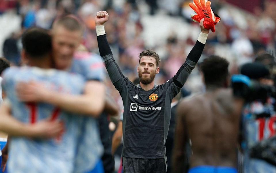 Manchester United's Spanish goalkeeper David de Gea celebrates on the pitch after the English Premier League football match between West Ham United and Manchester United - AFP