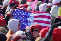 Supporters wait for President Donald Trump to arrive at a campaign rally at Dubuque Regional Airport, Sunday, Nov. 1, 2020, in Dubuque, Iowa. (AP Photo/Charlie Neibergall)