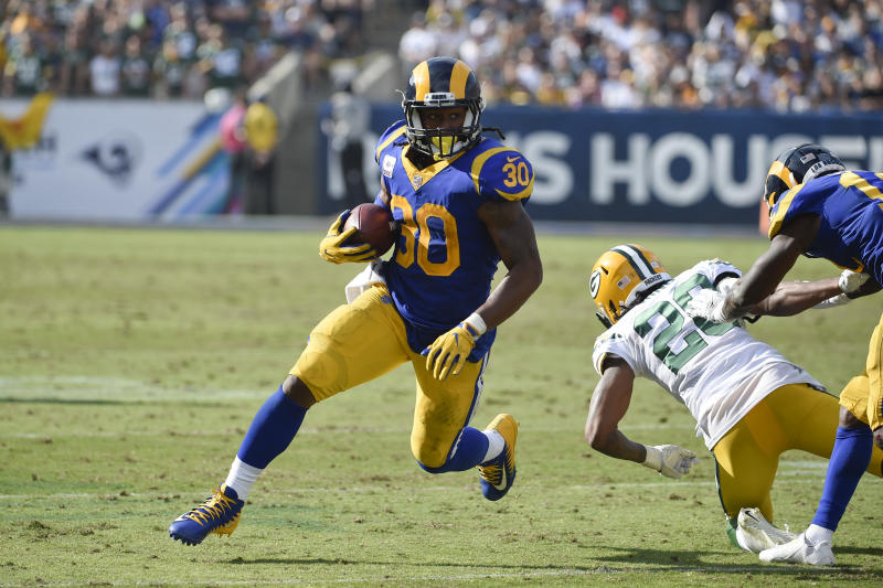 FILE - In this Sunday, Oct. 28, 2018, file photo, Los Angeles Rams running back Todd Gurley rushes during the second half of an NFL football game against the Green Bay Packers in Los Angeles. What some are calling the NFL's Game of the Year already has made huge headlines by being moved out of Mexico City because of poor playing conditions. Chiefs-Rams is back in Los Angeles. (AP Photo/Denis Poroy, File)