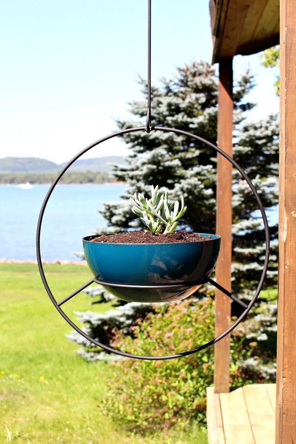 """<p>Hanging planters add great visual appeal to any setting. Opt for a more contemporary version by making this cool hoop planter. </p><p><strong>Get the tutorial at <a href=""""https://www.danslelakehouse.com/2018/10/vintage-hoop-planters-buy-diy.html"""" rel=""""nofollow noopener"""" target=""""_blank"""" data-ylk=""""slk:Dans le Lakehouse"""" class=""""link rapid-noclick-resp"""">Dans le Lakehouse</a>.</strong></p><p><a class=""""link rapid-noclick-resp"""" href=""""https://go.redirectingat.com?id=74968X1596630&url=https%3A%2F%2Fwww.walmart.com%2Fip%2FBlack-Rust-Oleum-American-Accents-2X-Ultra-Cover-Ultra-Matte-Spray-Paint-12-oz%2F488512581&sref=https%3A%2F%2Fwww.thepioneerwoman.com%2Fhome-lifestyle%2Fgardening%2Fg36556911%2Fdiy-planters%2F"""" rel=""""nofollow noopener"""" target=""""_blank"""" data-ylk=""""slk:SHOP SPRAY PAINT"""">SHOP SPRAY PAINT</a></p>"""