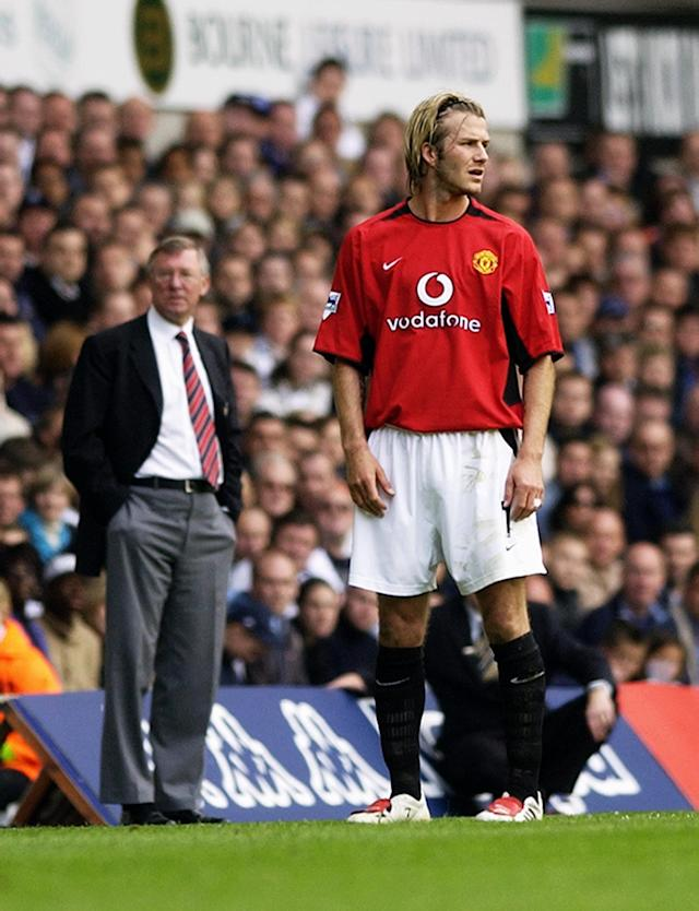 LONDON - APRIL 27: David Beckham of Manchester United and his manager Sir Alex Ferguson look in different directions during the FA Barclaycard Premiership match between Tottenham Hotspur and Manchester United held on April 27, 2003 at White Hart Lane, in London. Manchester United won the match 2-0. (Photo by Shaun Botterill/Getty Images)