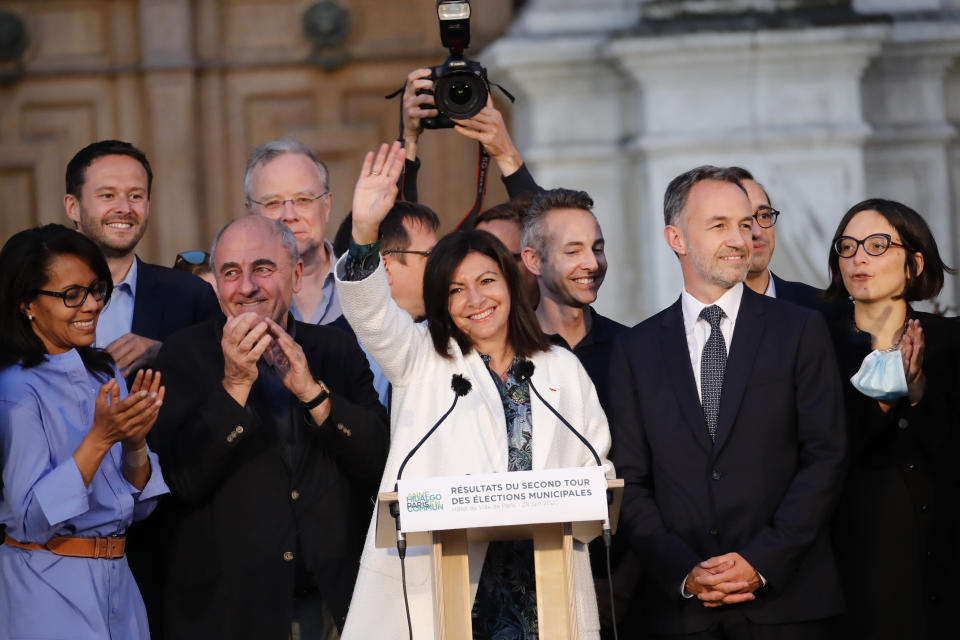 Paris mayor Anne Hidalgo, center, celebrates her reelection after the second round of the municipal election, Sunday, June 28, 2020 in Paris. France on Sunday held the second round of municipal elections that has seen a record low turnout amid concerns over the coronavirus outbreak and anger at how President Emmanuel Macron's government handled it. (AP Photo/Christophe Ena)