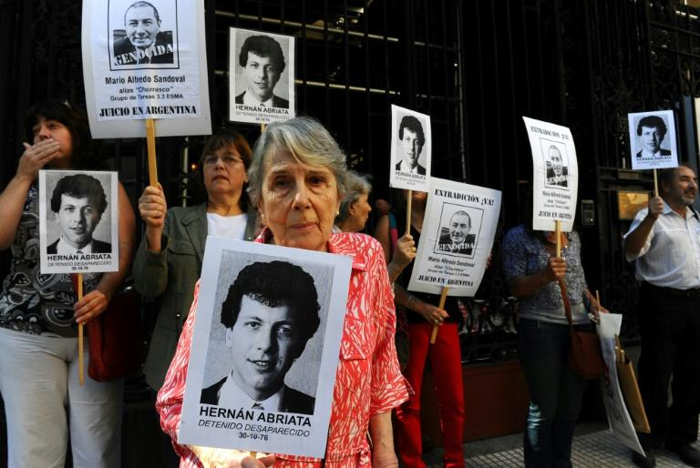 """Abriata's 92-year-old mother Beatriz Cantarini de Abriata, shown here at a protest in 2014, is """"desperately waiting"""" for his trial, a lawyer for Argentina told AFP"""