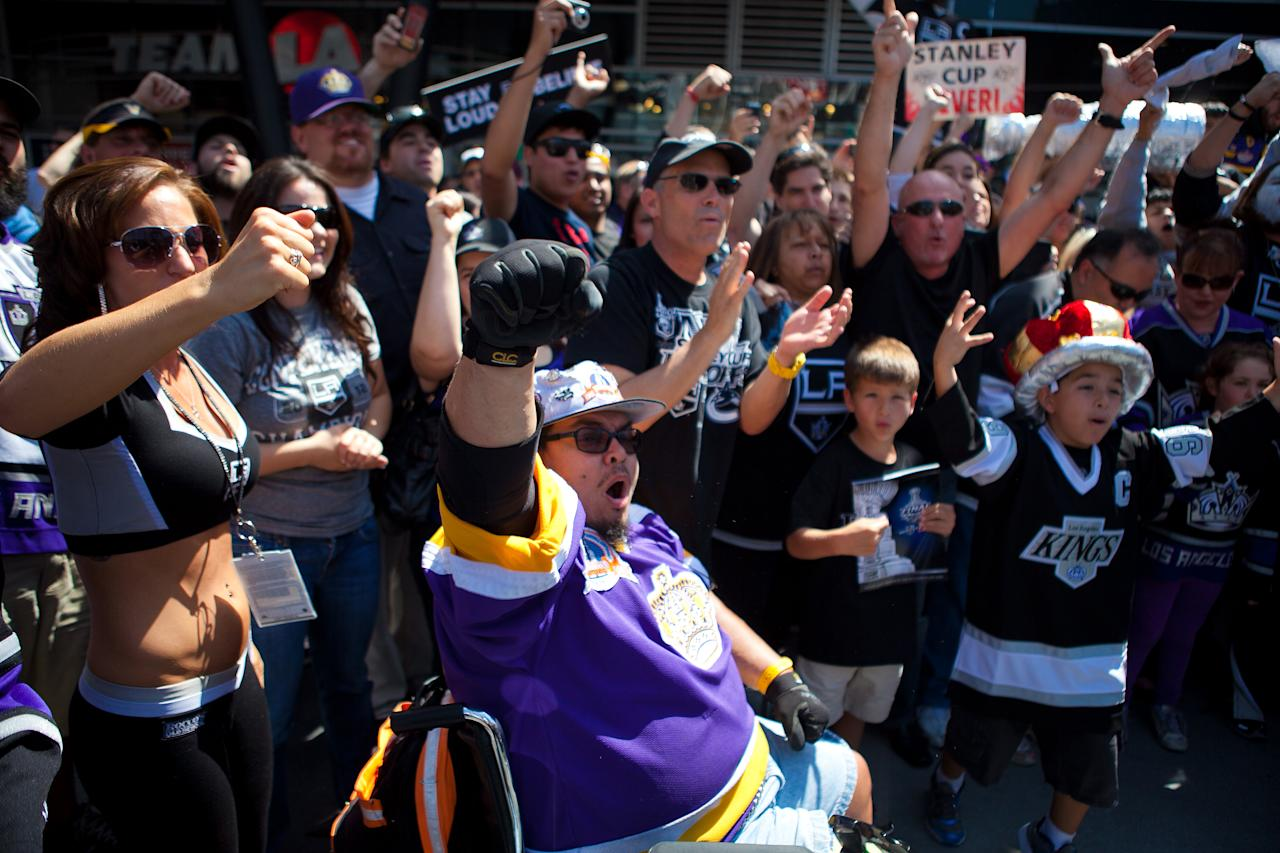 LOS ANGELES, CA - JUNE 11: Los Angeles Kings fans rally in front of the Staples Center before the start of Game 6 of the 2012 Stanley Cup Final June 11, 2012 in Los Angeles, California. A win in Game 6 against the New Jersey Devils would lead the Los Angeles Kings to their first championship in franchise history. (Photo by Jonathan Gibby/Getty Images)