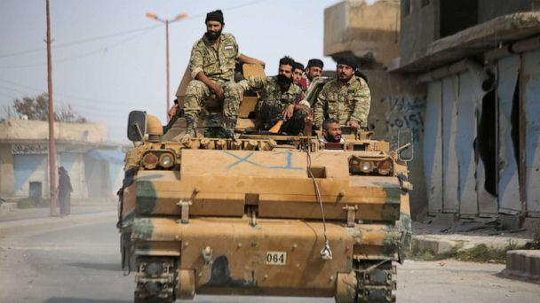 PHOTO: Turkish-backed Syrian fighters are pictured in the town of Ayn al-Arus, south of the border town of Tal Abyad, on Oct. 14, 2019. (Bakr Alkasem/AFP via Getty Images)