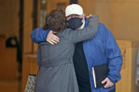 Michael Skakel hugs someone as he arrives to a courthouse in Stamford, Conn., Friday, Oct. 30, 2020. Skakel, a Kennedy cousin, is expected at a court hearing as Connecticut prosecutors decide whether to retry him for the bludgeoning death of a fellow teenager in 1975. (AP Photo/Seth Wenig)