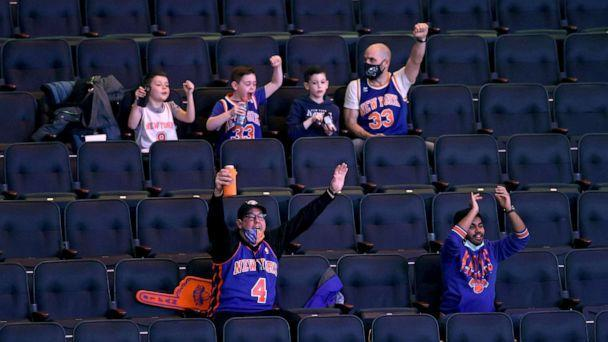 PHOTO: New York Knicks fans cheer as the team takes the court before the game against the Indiana Pacers at Madison Square Garden, Feb. 27, 2021, in New York City. (Elsa/Getty Images, FILE)
